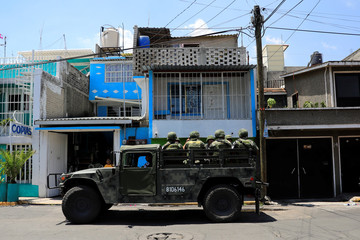 Members of the National Guard patrol around the neighborhoods in the Iztapalapa borough of Mexico City
