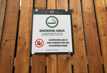 A sign is posted on a fence in the concessions area baning the use of cannabis on the grounds during the Calgary Stampede in Calgary