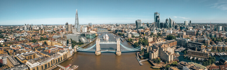 Fotomurales - Tower Bridge in London, the UK. Bright day over London. Drawbridge opening. One of English iconic symbols.
