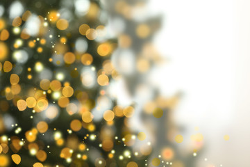 Fotobehang - Blurred view of Christmas tree with glowing lights. Bokeh effect