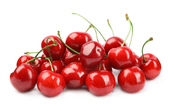 Heap of ripe sweet cherries on white background