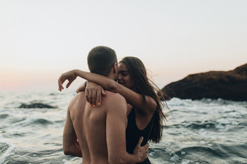 lovely couple kissing in the sea