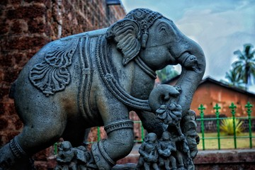 An elephant sclupture outside a temple