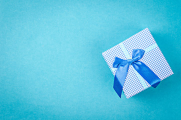 Blue background with presents and ribbons.