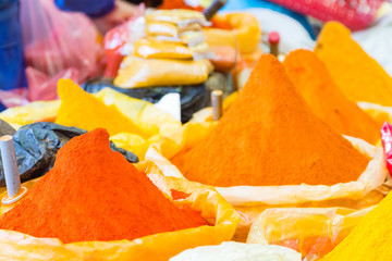 Bags of colorful spices background