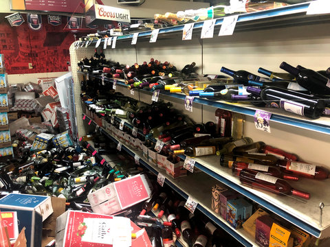 Toppled bottles of wine are seen after an earthquake at Eastridge Market in Ridgecrest, California
