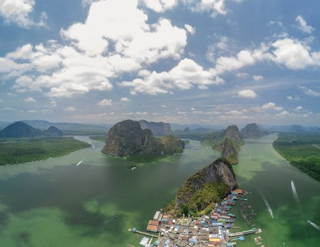Aerial shot of a village and towering islands of Koh panyi, Thailand