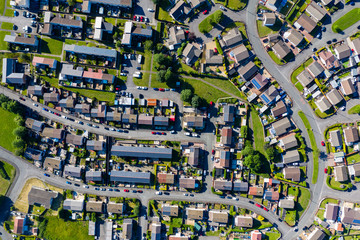 Aerial drone view of small winding sreets and roads in a residential area of a small town Fototapete