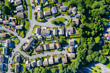 Obraz Aerial drone view of small winding sreets and roads in a residential area of a small town - fototapety do salonu
