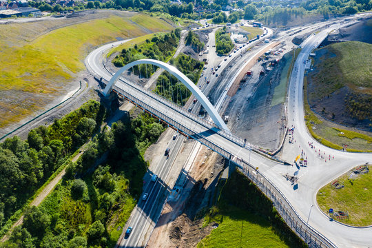 Aerial view of a new suspension bridge above roadworks (A465, Wales)