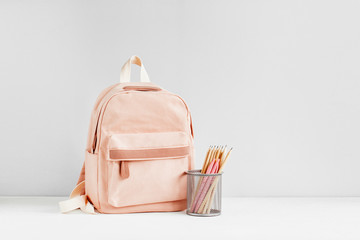 Backpack with school supplies for study. Back to school concept. Flat lay, top view