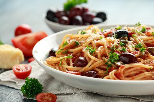 Pasta Alla Puttanesca with garlic, olives, capers, tomato and anchois fish