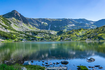 Wall Mural - Fish lake, one of the seven rila lakes in Bulgaria