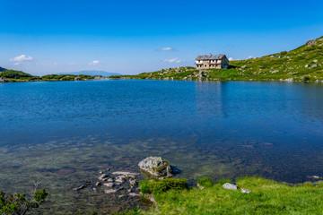 Fototapete - Fish lake, one of the seven rila lakes in Bulgaria with Seven lakes hut