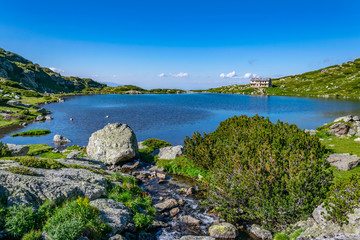 Wall Mural - Fish lake, one of the seven rila lakes in Bulgaria with Seven lakes hut