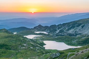 Wall Mural - Sunrise aerial view of seven rila lakes in Bulgaria