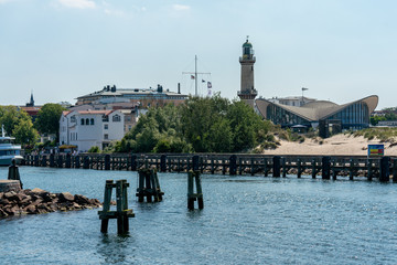 view on Warnemuende lighthouse and Teepott from a ship