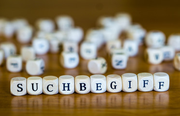 Keyword written in German with wooden cube