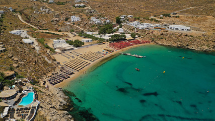Aerial drone photo of iconic organised beach of Super Paradise with emerald clear sandy seascape, Mykonos island, Cyclades, Greece