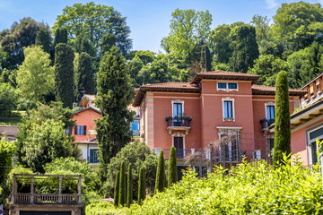 Fototapete - Old street in Bergamo, Italy. Beautiful scene in Lower City of Bergamo in summer. Picturesque view of vintage houses in greenery in the ancient town.