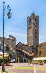 Fototapete - Piazza Vecchia in Citta Alta, Bergamo, Italy. Ancient architecture of Old town or Upper City in Bergamo. Medieval bell tower with clock in the ancient Bergamo center in summer.
