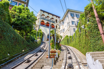 Fototapete - View of Citta Alta houses from funicular, Bergamo, Italy. Funicular San Vigilio connects old Upper City and new. Scenic panorama of beautiful road in the Bergamo historical center in summer.