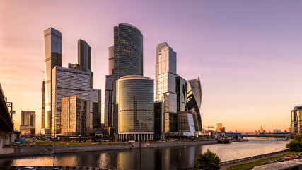 Wall Mural - Moskva River with Moscow-City at sunset, Russia. Moscow-City is a new district of business and residential tall buildings in the Moscow center. Panoramic view of Moscow with modern skyscrapers.