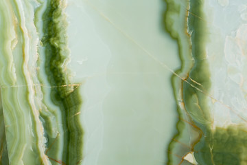 Elegant natural onyx background in light green tone.