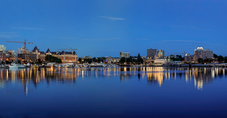Panorama of Victoria BC inner harbor at night.