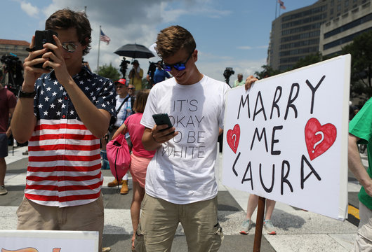 """A far-right activist wears a t-shirt that reads """"It's Okay to Be White"""" at a rally for free speech at Freedom Plaza in Washington"""