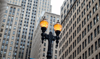 Fototapete - Chicago city downtown, Illuminated street lamps on skyscrapers background