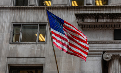 Fototapete - American flag in Chicago, Illinois downtown. Classic building facade background.