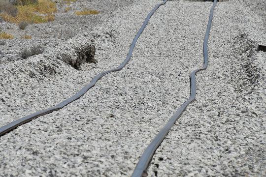 Railroad tracks bent by an earthquake lie in a railbed near Trona