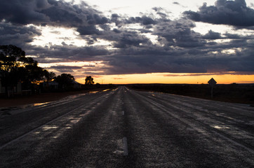 Cloudy, orange sunset after heavy rain (Australia), view from the road