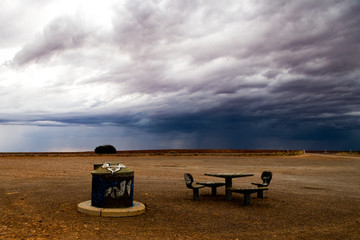 Abandoned rest stop with bench and table (seating) right before the storm (Northern Territory, Australia)