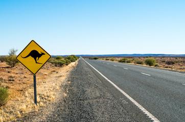 Yellow Kangaroo (roo, skippy) sign next to the highway (road) in Northern Territory (Australia)