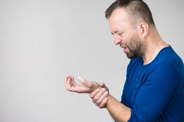 Man feeling pain in wrist