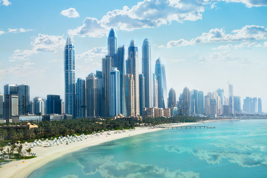 Dubai, UAE United Arabs Emirates. City of skyscrapers, Dubai marina in the sunny day with front line of beach hotels and blue water of Persian gulf