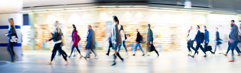 Beautiful motion blur of walking people in train station. Early morning rush hours, busy modern life concept. Ideal for websites and magazines layouts Fotomurales