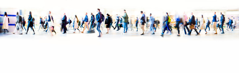 Beautiful motion blur of walking people in train station. Early morning rush hours, busy modern life concept. Ideal for websites and magazines layouts Wall mural