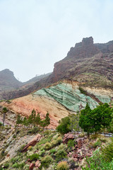 """Natural phenomenon of the colorful mountains in the west of the island of Gran Canaria / so-called """"Fuente de los Azulejos"""""""