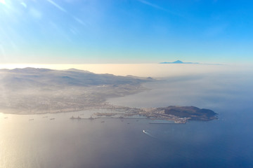 """Capital of Gran Canararia from above / Las Palmas with harbor / Volcano """"Teide"""" in the back and peninsula """"La Isleta"""" in the front"""