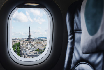 Traveling Paris, France famous landmark and travel destination in Europe. Aerial view Eiffel Tower through airplane window	 Fototapete
