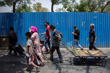 People walk at Grand Bazaar in Tehran