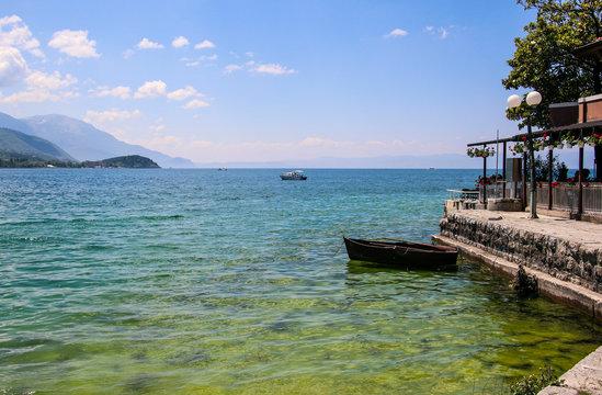 Beautiful view of Ohrid Lake with a fishing boat, Republic of North Macedonia