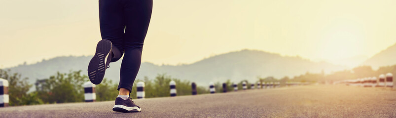 close up of woman leg in running start to reach the goal. Jogging workout and sport healthy lifestyle concept. proportion of the banner for ads. Wall mural