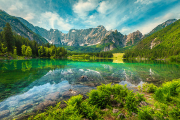 Wall Mural - Alpine landscape with lake Fusine and Mount Mangart, Italy
