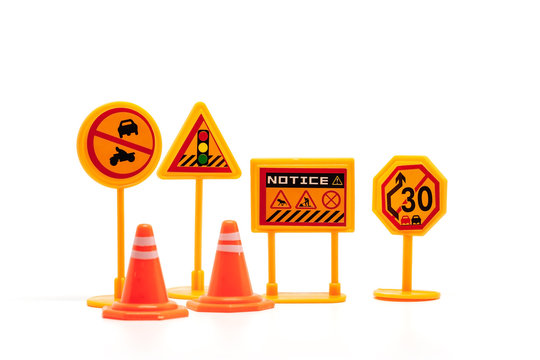 Set of mini traffic sign toy on white background for transportation concept