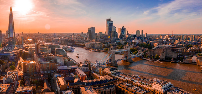 Arial view of London with the River Thames floating through the city near the Tower Bridge, London City and Westminster Abbey.