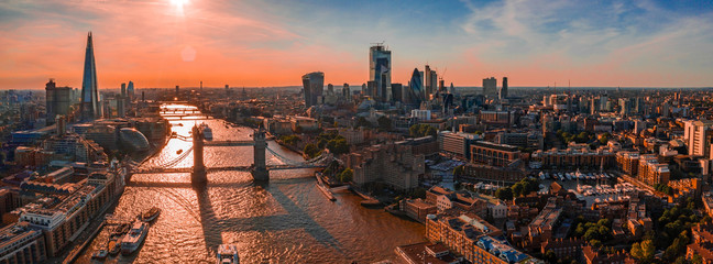 Fotomurales - Arial view of London with the River Thames floating through the city near the Tower Bridge, London City and Westminster Abbey.